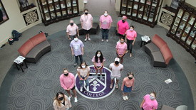 SHC Students wearing pink shirts stand in the shape of the cancer ribbon.  (photo: Stuart Babington)
