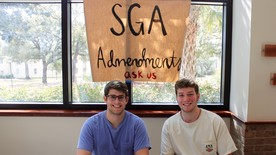 SGA members Ryan Ankerson and Adam Schmitt sit at the back of the student center to answer questions. (photo: Kate Huete)