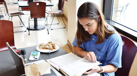SHC student Carmen Smith studies in the Barter Student Center. (photo: Emily Creasey)