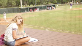 Studying at the baseball field offers entertainment and fresh air.  (photo: Breanne Bizette )