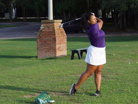 Lauryn Herman practices at the SHC driving range. (photo: )