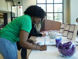 Students sign up at the Give Day table in the cafeteria.  (photo: )