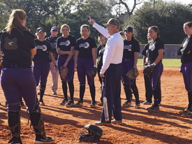 Softball coach prepares his team for an upcoming game. (photo: )