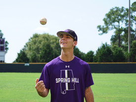 Pitcher Christian Long tosses a baseball before practice. (photo: Kayley Robinson)