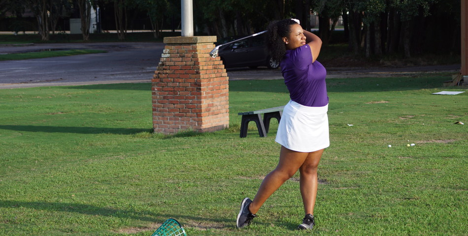 : Lauryn Herman practices at the SHC driving range.