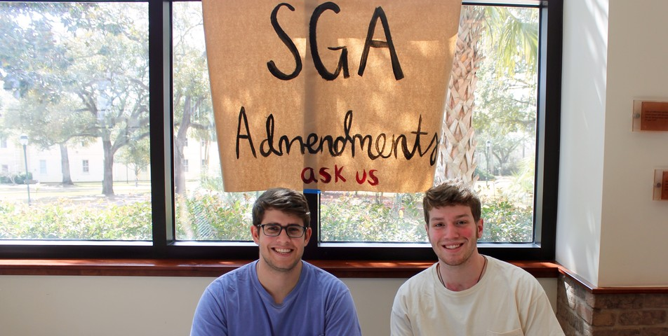 Kate Huete: SGA members Ryan Ankerson and Adam Schmitt sit at the back of the student center to answer questions.