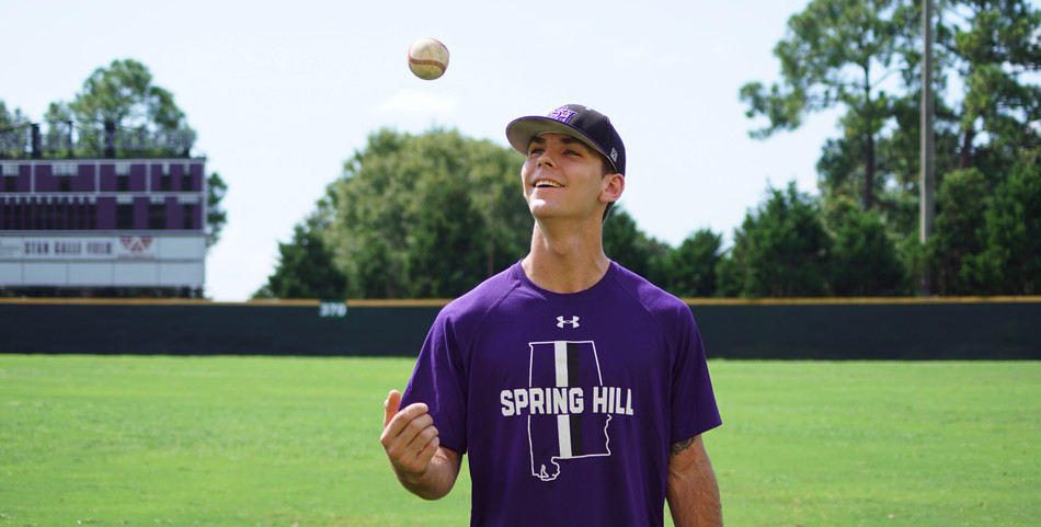 Kayley Robinson: Pitcher Christian Long tosses a baseball before practice.