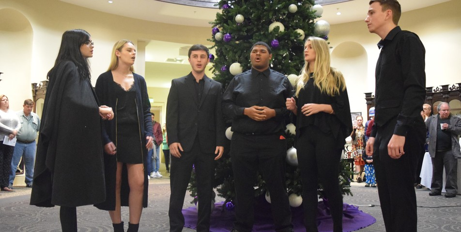 hannah martin members of the upper room acapella group perform at the lighting of spring
