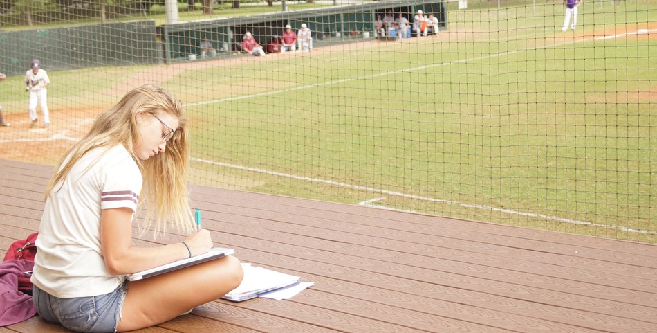 Breanne Bizette : Studying at the baseball field offers entertainment and fresh air.